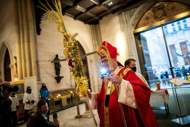 Cardinal Timothy Dolan attends the traditional Palm Sunday service to mark the beginning of Holy Week and Easter, during the coronavirus disease (COVID-19) pandemic, at St. Patrick's Cathedral, in New York, U.S., March 28, 2021. (Photo by Eduardo Munoz/Reuters)