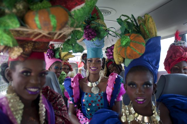 Carnival queens pose for a photo inside a bus upon their arrival to the National Palace to attend a ceremony inaugurating Carnival celebrations, in Port-au-Prince, Haiti, Sunday, February 15, 2015. (Photo by Dieu Nalio Chery/AP Photo)