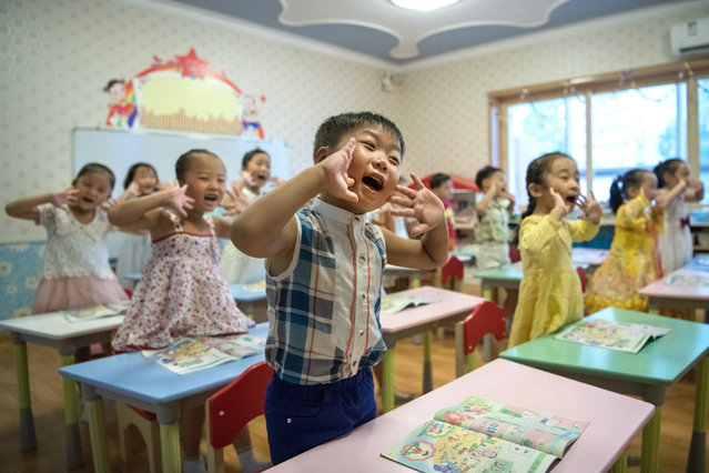 Children gesture and shout at the instruction of a teacher at Gyongsang Kindergarten on August 23, 2018 in Pyongyang, North Korea. (Photo by Carl Court/Getty Images)