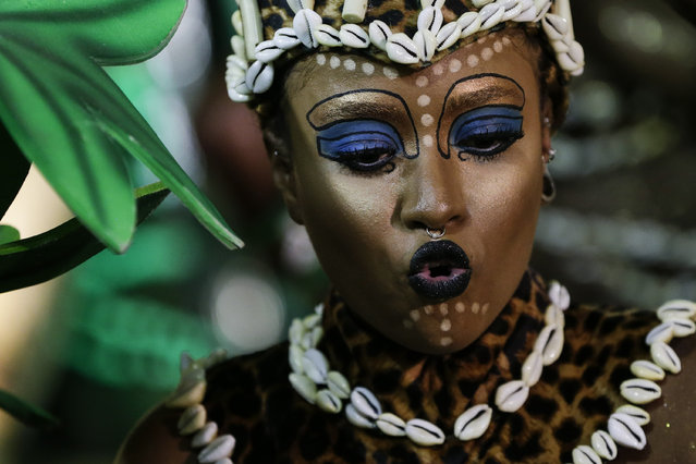 A performer from the Beija Flor samba school sings during Carnival celebrations at the Sambadrome in Rio de Janeiro, Brazil, Tuesday, February 17, 2015. (Photo by Felipe Dana/AP Photo)
