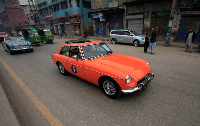 A man drives his classic car during the 7th Vintage Classic Car Rally as they pass through Peshawar, Pakistan November 20, 2016. (Photo by Fayaz Aziz/Reuters)
