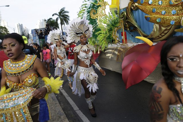 Revellers ahead of the last day of the annual Carnival parade in Panama City, February 17, 2015. (Photo by Carlos Jasso/Reuters)