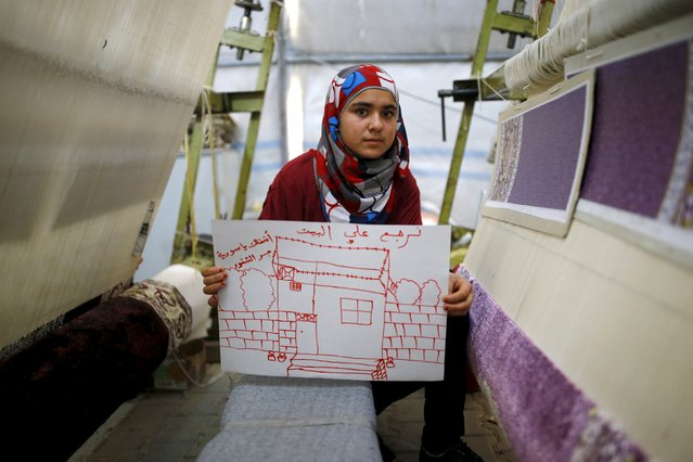 "Syrian refugee Meryem Mahmo, 14, shows a drawing of her home during a carpet weaving workshop in Midyat refugee camp in Mardin province, Turkey, December 14, 2015. The Arabic writing on the picture reads: ""I want my home. I miss you Syria"". (Photo by Umit Bektas/Reuters)"