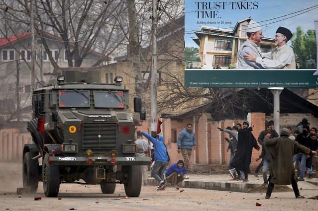 Protesters throw stones at an Indian army vehicle during a protest in Srinagar, January 14, 2016. (Photo by Danish Ismail/Reuters)