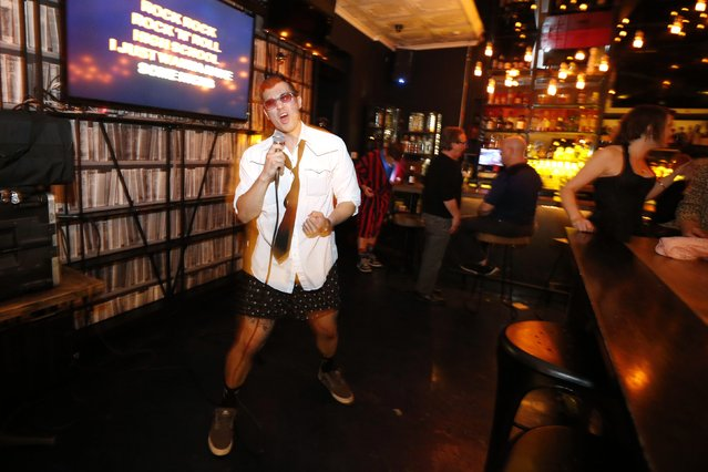 Cheech Poli, 28, sings at the first annual Underwear Karaoke, an event that pairs two common fears: being seen in your underwear and singing in public, in Los Angeles, California March 12, 2015. (Photo by Lucy Nicholson/Reuters)
