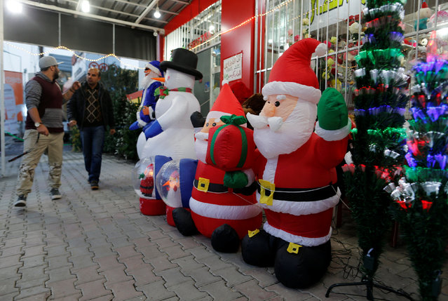 Iraqi people shop for Christmas decorations at a market in the northern Iraqi city of Erbil, December 23, 2016. (Photo by Ammar Awad/Reuters)