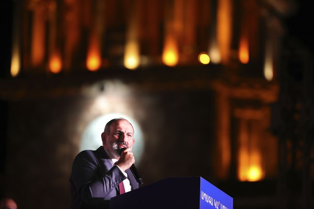 Armenian acting Prime Minister Nikol Pashinyan speaks during a rally in his support after winning snap parliamentary elections in Yerevan, Armenia, Monday, June 21, 2021. Voting results show that the party of Armenia's acting Prime Minister Nikol Pashinyan has won snap parliamentary elections which he called to ease anger over a peace deal he signed with Azerbaijan. The election commission said Pashinyan's Civil Contract party won 53.9% of the vote. Former President Robert Kocharyan's bloc was a distant second with about 21%. (Photo by Tigran Mehrabyan/PAN Photo via AP Photo)