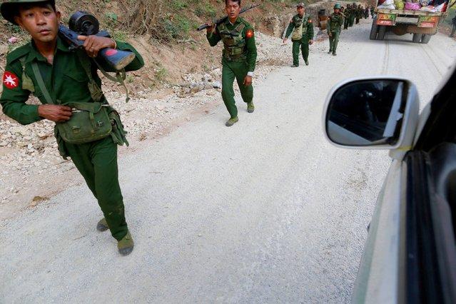 Myanmar army soldiers walk along a road near Laukkai February 17, 2015. (Photo by Soe Zeya Tun/Reuters)
