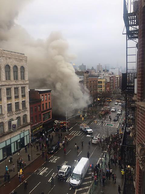 Smoke pours from a building after it collapsed in New York City's East Village as seen in this picture taken by Scott Westerfeld March 26, 2015. (Photo by Scott Westerfeld/Reuters)