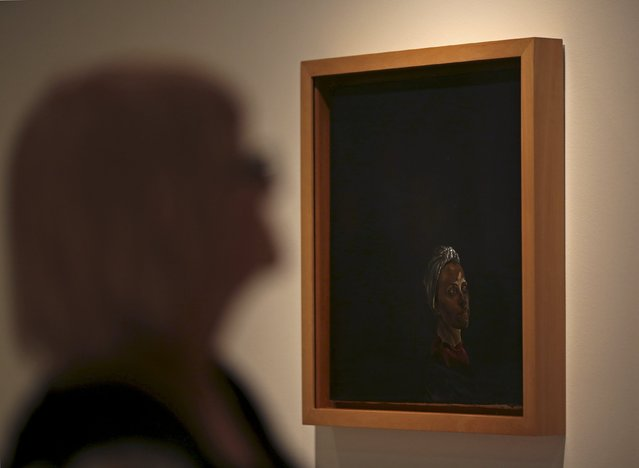 """A person walks in front of the painting """"Portrait of Gata with Turban"""" from 1939 by Spanish artist Salvador Dali at the exhibition """"Picasso and the Spanish Modernity"""" at Centro Cultural Banco do Brazil in Sao Paulo March 25, 2015. (Photo by Paulo Whitaker/Reuters)"""