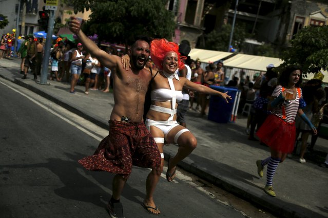 "Revellers take part in an annual block party known as ""Cordao de Prata Preta"", one of the many carnival parties to take place in the neighbourhoods of Rio de Janeiro, February 6, 2016. (Photo by Pilar Olivares/Reuters)"