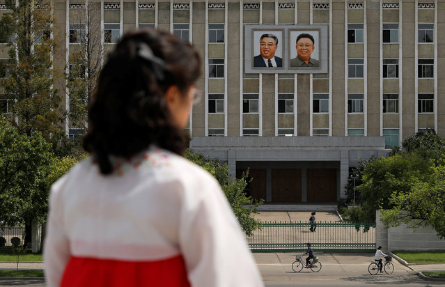 Portraits of late North Korean leaders Kim Il Sung and Kim Jong Il are seen on the facade of a government building in Pyongyang, North Korea, September 11, 2018. (Photo by Danish Siddiqui/Reuters)