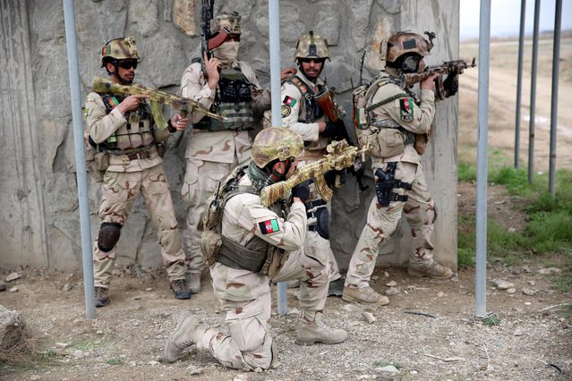 Afghanistan's interior ministry special forces take position during a military exercise in Kabul, Afghanistan, Thursday, April 2, 2015. (Photo by Massoud Hossaini/AP Photo)