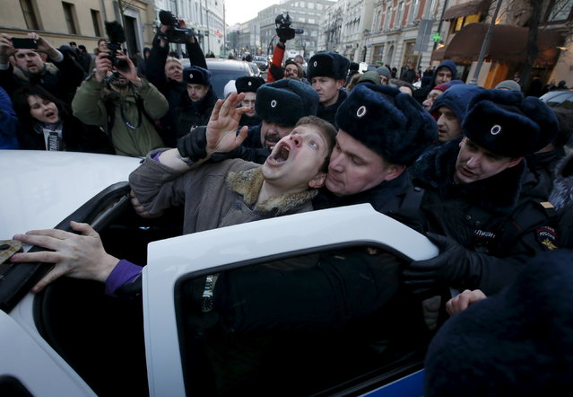 Police officers detain an activist who was taking part in a rally of foreign currency mortgage holders, near the Central Bank headquarters in central Moscow, Russia, February 8, 2016. (Photo by Sergei Karpukhin/Reuters)