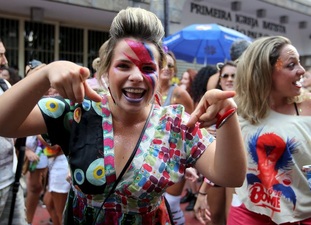 "Revellers parade during the annual block party known as ""To de Bowie"" (Meanwhile, I'm with David Bowie), in downtown Sao Paulo, Brazil February 9, 2016. (Photo by Paulo Whitaker/Reuters)"