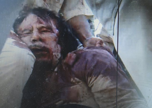 Late Libyan leader Muammar Gaddafi is seen in this still image taken from video footage October 20, 2011 after being captured and killed by rebels in Sirte. (Photo by Esam Al-Fetori/Reuters)