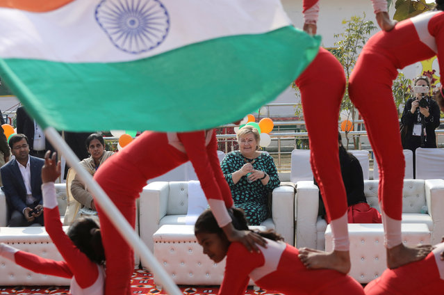 Norway's Prime Minister Erna Solberg watches a performance by schoolgirls during her visit to a government-run school in Ghaziabad, on the outskirts of New Delhi, India, January 7, 2019. (Photo by Anushree Fadnavis/Reuters)