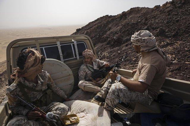 Yemeni fighters backed by the Saudi-led coalition ride in a truck on the Kassara frontline near Marib, Yemen, Sunday, June 20, 2021. (Photo by Nariman El-Mofty/AP Photo)