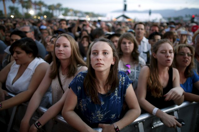 """Fans watch the band """"Alabama Shakes"""" playing at the Coachella Valley Music and Arts Festival in Indio, California April 10, 2015. (Photo by Lucy Nicholson/Reuters)"""