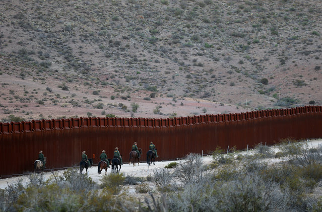 U.S. Border Patrol agents on horseback head out on patrol along the U.S.-Mexico border fence near Jacumba, California, U.S., November 14, 2016. (Photo by Mike Blake/Reuters)