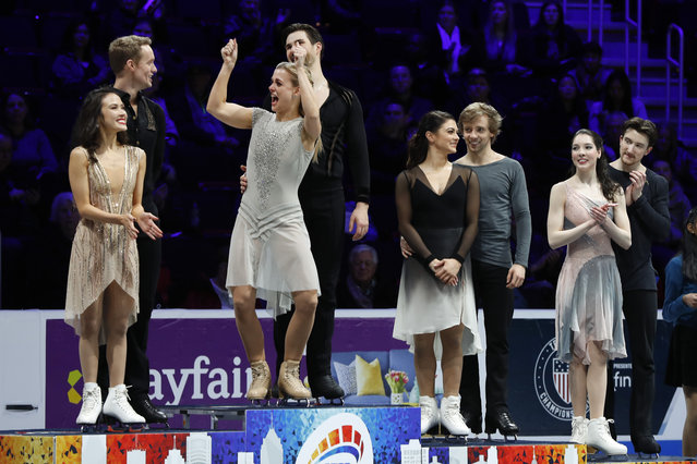 Madison Chock and Evan Bates, left, who placed second, watch Madison Hubbell and Zachary Donohue, who won, react on the medal stand for ice dancing, next to Kaitlin Hawayek and Jean-Luc Baker, third place, and Lorraine McNamara and Quinn Carpenter, fourth place, at the U.S. Figure Skating Championships, Saturday, January 26, 2019, in Detroit. (Photo by Paul Sancya/AP Photo)