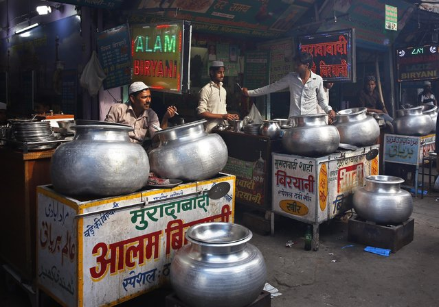 Wayside vendors sell Biryani, a rice dish mixed with meat and spices in New Delhi, India, Tuesday, April 7, 2015.(Photo by Manish Swarup/AP Photo)