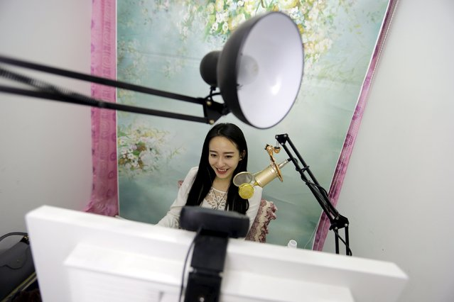 Online hostess Sun Xiaohou smiles as she gives a live broadcast in Beijing April 4, 2015. (Photo by Jason Lee/Reuters)