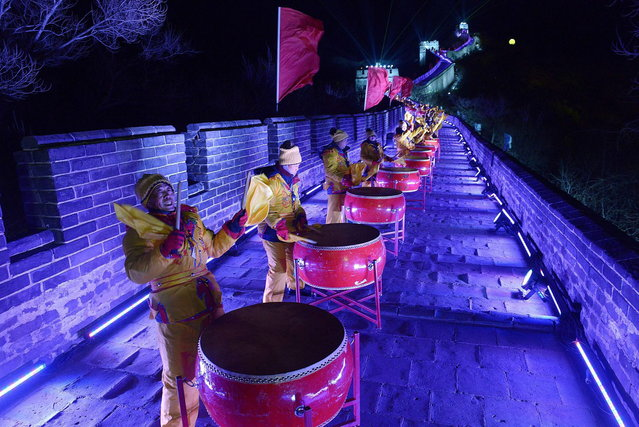 People dressed in traditional costumes play drums during a performance to celebrate the new year at the Great wall in Beijing on December 31,2013. Hundreds of people gathered at the Great Wall, a landmark place in Beijing, to celebrate the New Year. (Photo by Wang Zhao/AFP Photo)