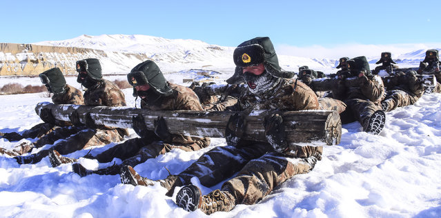 Frontier soldiers attend a drill in minus 16 degrees Celsius on February 18, 2019 in Ngari Prefecture, Tibet Autonomous Region of China. (Photo by Liu Xiaodong/VCG via Getty Images)