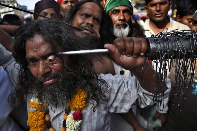Indian Muslim Sufi devotee use sharp objects to self-flagellate in a procession during the Urs festival at the shrine of Sufi saint Khwaja Moinuddin Chishti in Ajmer, India, Sunday, April 19, 2015. (Photo by Deepak Sharma/AP Photo)