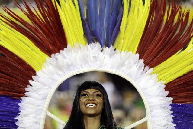 A performer from the Imperatriz Leopoldinense samba school parades during Carnival celebrations at the Sambadrome in Rio de Janeiro, Brazil, Monday, March 4, 2019. (Photo by Leo Correa/AP Photo)