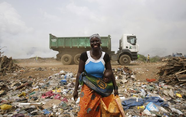 Kalandjibo Balo, a 23-year-old woman who recycles plastic for a living, poses for a photograph at Akouedo dump in Abidjan, Ivory Coast February 25, 2016.. (Photo by Thierry Gouegnon/Reuters)