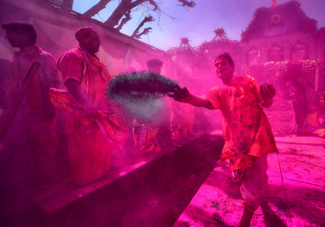 Hindu devotees playing with colourful powders and water during the Holi Festival celebration at Gokul dham, Mathura, India on March 18, 2019. (Photo by Avishek Das/SOPA Images/Rex Features/Shutterstock)