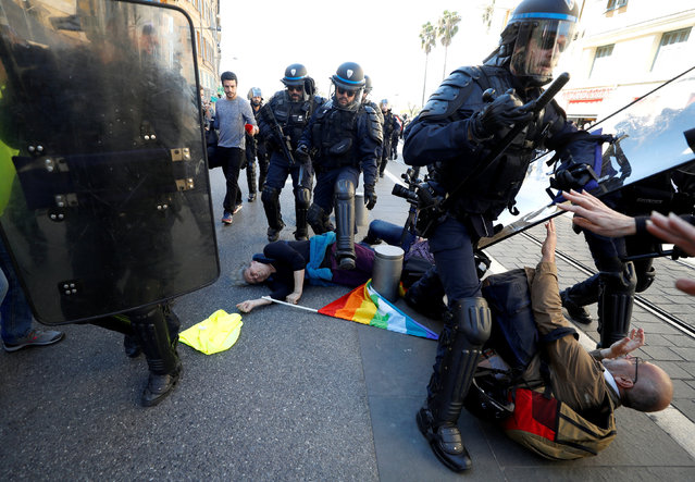 """People lay on the ground as riot police try to disperse the crowd as French """"yellow vests"""" stage their 19th round of protests in Nice, France, March 23, 2019. (Photo by Eric Gaillard/Reuters)"""