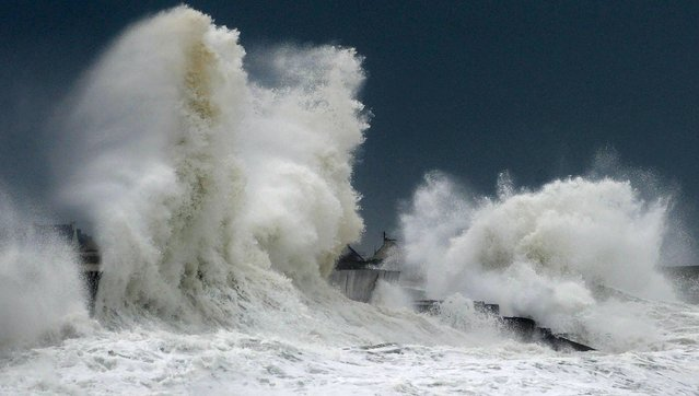 Huges waves break on a harbour wall at the port of Lesconil, western France, on February 3, 2017. Storms will hit the northwest of the country, according to meteorologists. They have also given orange alert for the departments of Finistere, Cotes-d'Armor, Morbihan and Manche with gale force winds and strong waves, with the risk of flooding in some areas. (Photo by Fred Tanneau/AFP Photo)