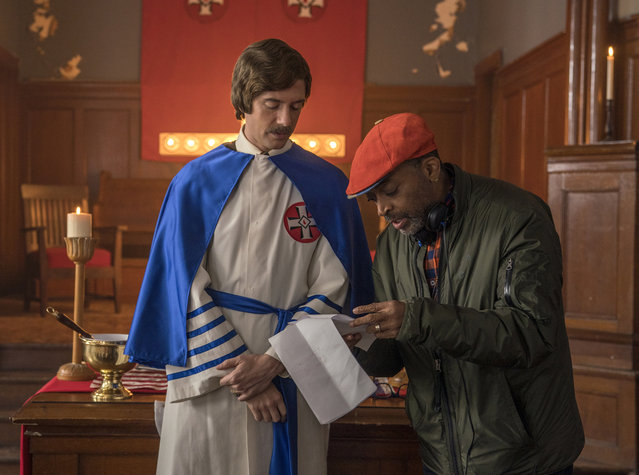 "This image released by Focus features shows  Topher Grace, left, with director Spike Lee on the set of ""BlacKkKlansma"". Lee was nominated for an Oscar award for best director for his film, ""BlacKkKlansman"". The film was also nominated for best picture. (Photo by David Lee/Focus Features via AP Photo)"