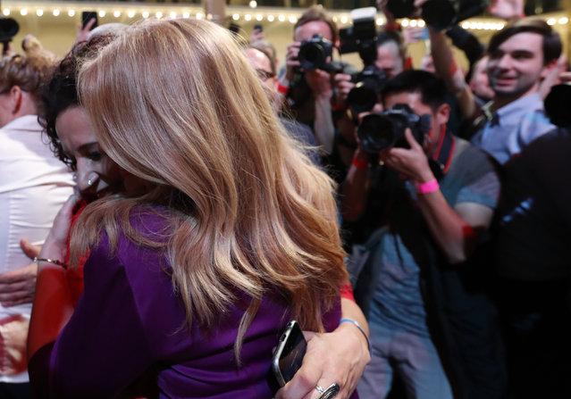 Presidential candidate Zuzana Caputova hugs with a supporter after acknowledging the first preliminary results of the second round of the presidential election in Bratislava, Slovakia, Saturday, March 30, 2019. Voting has ended in the runoff of Slovakia's presidential election, and early results show a favorite female candidate in a lead. (Photo by Petr David Josek/AP Photo)