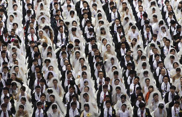 Couples from around the world participate in a mass wedding ceremony at the CheongShim Peace World Center in Gapyeong, South Korea, Wednesday, February 12, 2014. (Photo by Lee Jin-man/AP Photo)