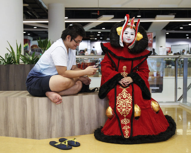 Star Wars fan Michelle Chee, 32, right, dressed up as Padme Amidala has a rest at a Star Wars Day gathering in a mall downtown Kuala Lumpur, Malaysia, Saturday, May 2, 2015. (Photo by Joshua Paul/AP Photo)