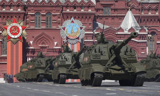 Russian army self-propelled howitzers drive along at the Red Square during a general rehearsal for the Victory Day military parade which will take place at Moscow's Red Square on May 9 to celebrate 70 years after the victory in WWII, in Moscow, Russia, Thursday, May 7, 2015. (Photo by Alexander Zemlianichenko/AP Photo)