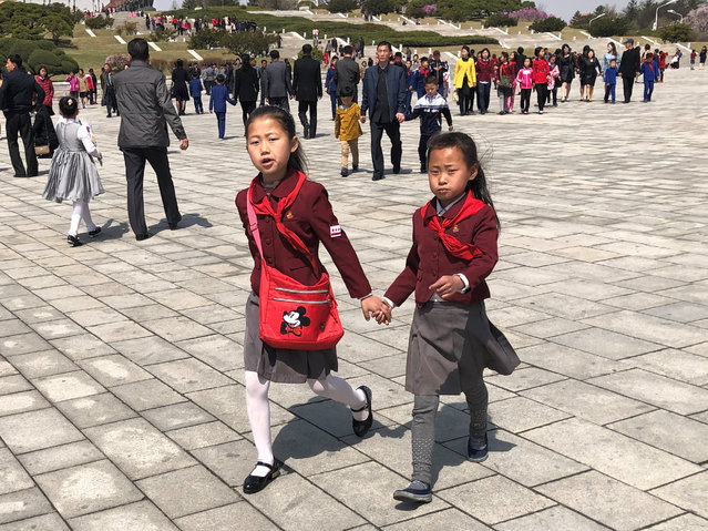 School students attend celebrations of Day of the Sun on Mansudae (Mansu) Hill by bronze statues of North Korean leaders Kim Il-sung and Kim Jong-il in Pyongyang, North Korea on April 14, 2019. Day of the Sun is an annual public holiday celebrated on April 15, the birth anniversary of Kim Il-sung, the founder of North Korea. (Photo by Yevgeny Agoshkov/TASS)