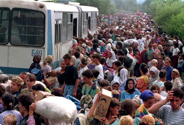 Around 10,000 refugees from Srebrenica are seen boarding buses at a camp outside the U.N. base at Tuzla Airport, July 1995. (Photo by Wade Goddard/Reuters)