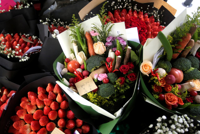 Bouquets made of vegetables, strawberries and flowers are seen in a vehicle as a delivery staff of a florist prepares to deliver them for clients on Valentine's Day in Beijing, China, February 14, 2017. (Photo by Jason Lee/Reuters)