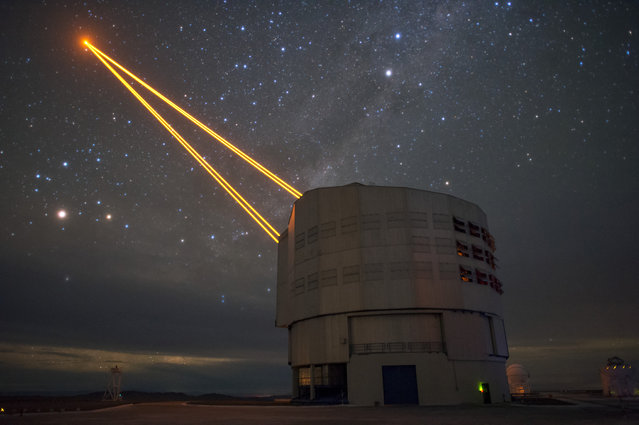 Four pillars of light from the 4 Laser Guide Star Facility on ESO's Very Large Telescope (VLT) are shown reaching into the Chilean night sky in this image from ESO Photo Ambassador Fred Kamphues, on September 2, 2016. The lasers are a key part of the adaptive optics system on the VLT. Adaptive optics allows astronomers to drastically reduce the atmospheric distortion present at even the best sites in the world for astronomy, including Paranal in Chile, the home of the VLT. (Photo by F. Kamphues/ESO)