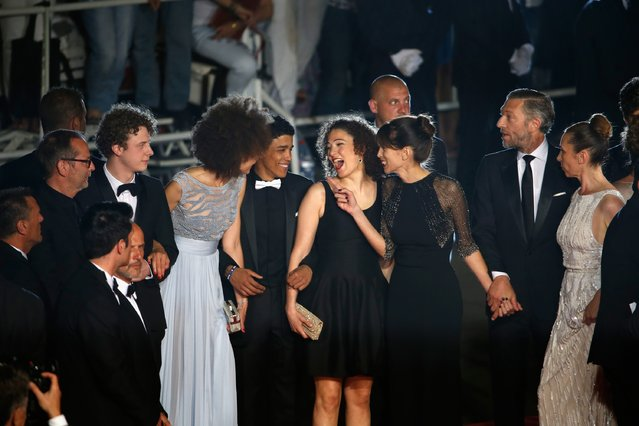 "(L-R) Scriptwriter Etienne Comar, actor Norman Thavaud, actress Chrystele Saint Louis Augustin, actor Nabil Kechouhen, actress Amanda Added, director Maiwenn, actor Vincent Cassel and Emmanuelle Berco attend the Premiere of ""Mon Roi"" during the 68th annual Cannes Film Festival on May 17, 2015 in Cannes, France. (Photo by Tristan Fewings/Getty Images)"