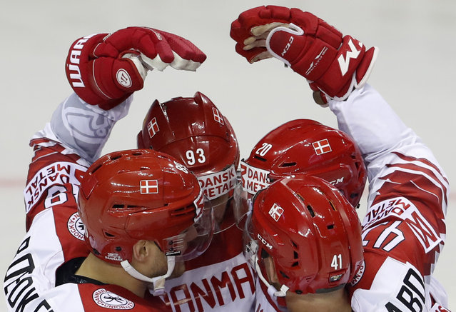 Denmark's Lars Eller, back right, celebrates with teammates after scoring a goal during the Ice Hockey World Championships group A match between Great Britain and Denmark at the Steel Arena in Kosice, Slovakia, Tuesday, May 14, 2019. (Photo by Petr David Josek/AP Photo)