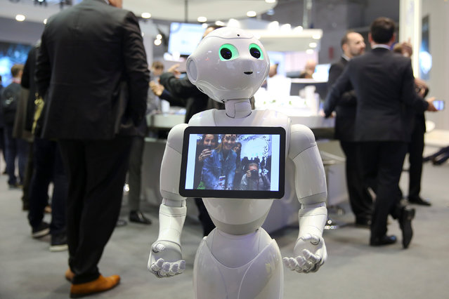 A robot displays a photograph it took of attendees at the Oberthur Technologies stand at the Mobile World Congress in Barcelona, Spain March 1, 2017. (Photo by Paul Hanna/Reuters)