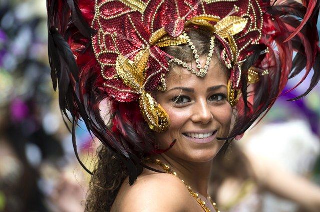 A dancer takes part in the Copenhagen Carnival parade May 23, 2015. (Photo by Jens Noergaard Larsen/Reuters/Scanpix Denmark)