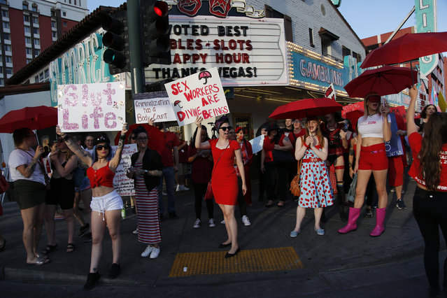 People chant as they march in support of s*x workers, Sunday, June 2, 2019, in Las Vegas. People marched in support of decriminalizing s*x work and against the Fight Online s*x Trafficking Act and the Stop Enabling s*x Traffickers Act, among other issues. (Photo by John Locher/AP Photo)
