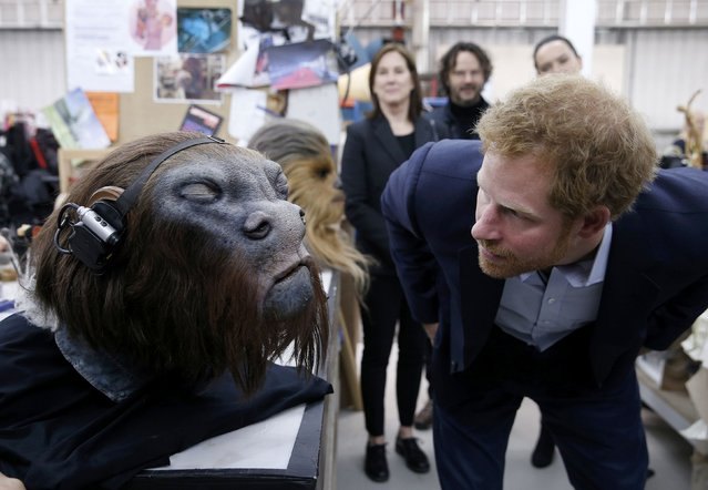 Britain's Prince Harry takes a closer look at a robotic mask during a tour of the Star Wars sets at Pinewood studios in Iver Heath, west of London, Britain on April 19, 2016. (Photo by Adrian Dennis/Reuters)